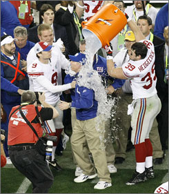 Giants coach Tom Coughlin gets the traditional Gatorade victory bath from Madison Hedgecock near the end of Super Bowl XLII.
