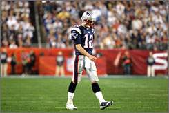 Patriots quarterback Tom Brady walks off the field during the fourth quarter of Super Bowl XLII on Sunday in Glendale, Ariz. Brady completed 29 of 48 passing attempts for 266 yards and a touchdown.