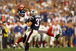 Patriots safety Rodney Harrison could not prevent Giants wideout David Tyree from sustaining the game-winning drive with this catch late in the fourth quarter of Super Bowl XLII on Sunday in Glendale, Ariz.