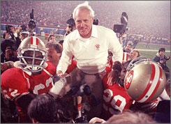 Bill Walsh, shown celebrating the second of his three Super Bowl titles with the 49ers in 1985, was honored during the coin toss before Super Bowl XLII on Sunday.