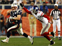 Patriots receiver Wes Welker eludes Giants cornerback Aaron Ross in the fourth quarter. Welker led New England in receiving with 11 catches for 103 yards.