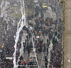 Ticker tape rains down on the New York Giants players during their Super Bowl victory parade through Manhattan.