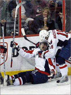 Alex Ovechkin celebrates his 46th  goal of the season with teammate Nicklas Backstrom during Washington's 4-3 victory over Phildelphia.