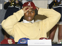Julio Jones put on an Alabama hat after revealing his decision to play for the Crimson Tide.