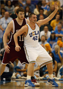 Kevin Love, here posting up against Washington State's Aron Baynes on Jan. 12, is averaging 22 points and 15 rebounds over the Bruins' last four games.
