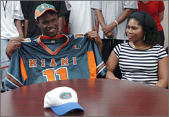 Palm Bay's Ramon Buchanan is all smiles next to his mother Charmaine Magnas after signing with Miami.