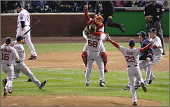 The Red Sox swarm closer Jonathan Papelbon, who struck out Colorado's Seth Smith, top left, for the final out as Boston swept the Rockies to win in the 2007 World Series.