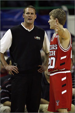 Pat Knight listens to Texas Tech player Alan Voskuil as the new coach's debut for the Red Raiders turned into a dud.