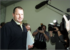 Roger Clemens is surrounded by photographers and reporters as he moves between meetings with members of Congress Thursday. In all, the 300-game winner visited 12 representatives in advance of his committee appearance next week.