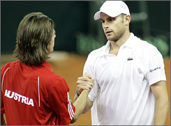 Andy Roddick, right, shake hands with Juergen Melzer after giving the United States a 1-0 lead on Austria.