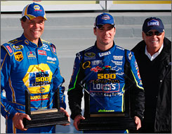 Last year's Cup Series champion, Jimmie Johnson, center, earned the pole for team owner Rick Hendrick, right, in next Sunday's season-opening Daytona 500. Michael Waltrip will start alongside Johnson on the front row after qualifying with the second-fastest speed.