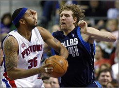 Rasheed Wallace, shown posting up Mavericks defender Dirk Nowitzki on Feb. 3, held Nowitzki to 3-for-18 shooting in the Pistons' 90-67 win and averaged 18.6 points for the week.