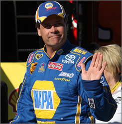 Michael Waltrip offers fans a wave after ensuring himself a spot in the Daytona 500.