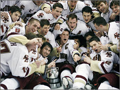 Boston College players celebrate the Eagles' 14th Beanpot title on the TD Banknorth Garden ice after dispatching Harvard in overtime.
