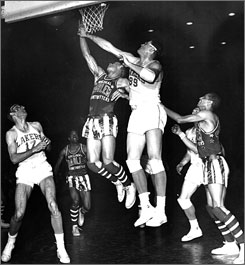 Lakers center George Mikan challenges the Globetrotters' Sweetwater Clifton during their game on Feb. 28, 1949. The stars from Harlem won 49-45, following up a victory over the world champions just days earlier, on Feb. 19.