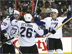 Martin St. Louis and Vincent Lecavalier celebrate Vaclav Prospal's goal in the Lightning's 5-3 win over Philadelphia on Thursday.