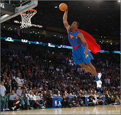 Dwight Howard didn't change uniforms in a phone booth, but played the part of Superman just as well in this crowd-pleasing slam in the second round.