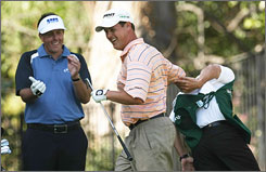 Phil Mickelson, left, can only stand and applaud as Jeff Quinney scores a hole-in-one on the par-3 sixth hole at Riviera Country Club. The ace was the highlight of Quinney's round of 67 that moved him into second place, one shot behind Mickelson entering Sunday's final round.