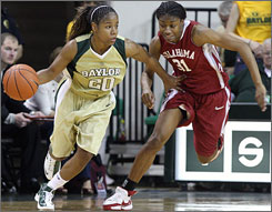 Baylor's Angela Tisdale, left, takes the ball upcourt as Oklahoma's Rose Hammond gives chase during the second half.