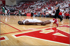 Indiana center D.J. White might not play Tuesday when the Hoosiers host Big Ten leader Purdue after hurting his left knee Saturday against Michigan State.