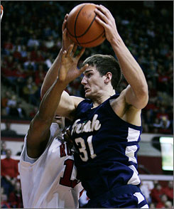 Notre Dame's Rob Kurz fights to get past the defense of Rutgers' JR Inman.