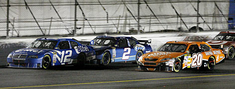 A Penske Racing freight train of Ryan Newman (12) and Kurt Busch (2) seize the lead from Tony Stewart on the final lap.