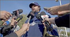 Milwaukee's Eric Gagne reads a statement as the Brewers open spring training in Phoenix. Depending on who he talked to, Gagne mentioned the Mitchell Report in his media session.