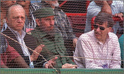 Longtime dictator Fidel Castro, pictured here with MLB commissioner Bud Selig and Baltimore Orioles owner Peter Angelos, has announced he will relinquish his role as president. Castro's resignation is expected to further relations between MLB and Cuba.