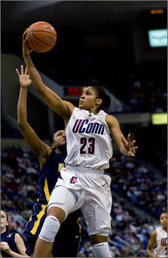 Freshman forward Maya Moore's 31 points helped lead the Huskies past Marquette for a 95-63 victory.  Moore scored 25 of her 31 points in the first half.