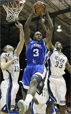 Joey Dorsey, pulling down a rebound against Rice last month, leads Memphis with 10.5 rebounds a game and is one of four Tigers players with bright prospects of playing in the pros.