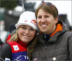 Lindsey Vonn, left, finished second on Friday, but it clinched the overall World Cup crown for the Utah skier.