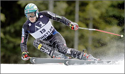 Bode Miller takes seventh in Saturday's World Cup giant slalom in British Columbia. The outspoken American heads to Europe leading the overall standings in a bid for a second title.