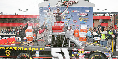Kyle Busch accepts the plaudits after winning the Craftsman Series event in Fontana, Calif.