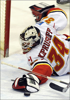 Calgary goalie Miikka Kiprusoff makes one of his 38 saves in the Flames' 2-1 win over the Minnesota Wild on Sunday.