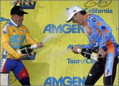 Levi Leipheimer, left, and Christian Vandevelde spray each other with champagne at the conclusion of the Tour of California on Sunday. Leipheimer finished first overall while Vandevelde placed third.