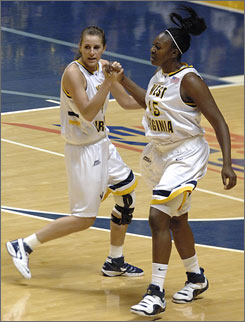 West Virginia seniors Meg Bulger, left, and Olayinka Sanni have reached 1,000 points in their West Virginia careers, Bulger despite missing more than a season with a knee injury.