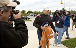 Roger Clemens arrives at the Houston Astros' spring training facility, where he was bombarded with questions regarding Congress' decision to investigate him for perjury while working out with minor leaguers.