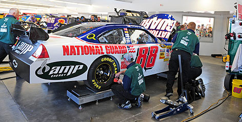 Dale Earnhardt Jr.'s crew works on his car at Las Vegas Motor Speedway where NASCAR kicked him out of the inspection line because of measurement violations.