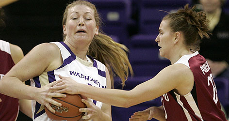 Washington's Kali Bennett had the ball that Stanford's Jeanette Pohlen wanted during their Pac-10 game in Seattle. The visiting Cardinal won 73-53 to move one game from the top seed in the conference tournament.