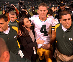 Brett Favre, with his wife, Deanna, played in a game at Oakland just one day after the death of his father, Irv, in 2003. The Packers won the game 41-7.