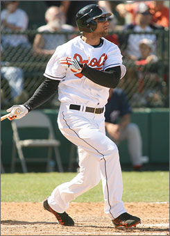 Baltimore's Nick Markakis launches a home run against Washington during their Grapefruit League game last Sunday.