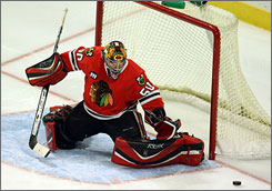 "In his first career NHL start, goalie Corey Crawford recorded a win and a shutout.  ""He played a heck of a game for us,"" Chicago coach Denis Savard said of Crawford. ""He knew this game was coming up a couple of days ago. It was important for him to prepare so he could be relaxed. He looked relaxed to me."""