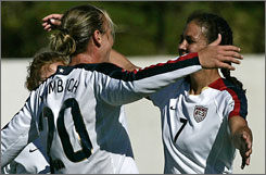 Abby Wambach celebrates her goal with Team USA teammates during the Americans' 4-0 win over China in the opening round of the Algarve Cup in Portugal on Wednesday.