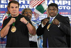 Oleg Maskaev, left, and Samuel Peter pose at an August 2007 news conference promoting their fight last October, which Maskaev pulled out of. The two square off on Saturday night in the first heavyweight title fight in Mexico.