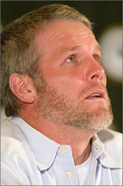 Longtime Packers quarterback Brett Favre tears up as he talks about his retirement Thursday during a news conference at Lambeau Field in Green Bay, Wis.