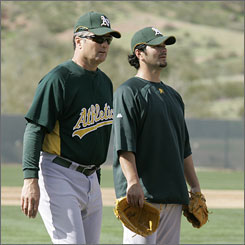 A's manager Bob Geren, left, says back trouble might stop Eric Chavez, one of the few veterans left, from going to Japan for the season-opening series.