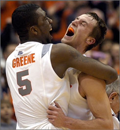 Syracuse's Donte Greene and Kristof Ongenaet celebrate after the Orange upset No. 20 Marquette to help boost their hopes for an at-large bid to the Big Dance.