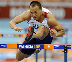 American Bryan Clay competes in the heptathlon's 60m hurdles at the World Indoor Track and Field Championships in Valencia, Spain. Clay won the event as a meet invitee after failing to qualify earlier in the season.