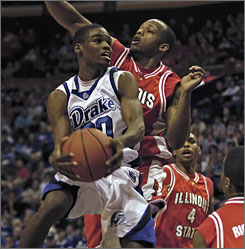 Illinois State's Emmanuel Holloway tries to stop a shot from Drake's Josh Young during the MVC title game in St. Louis. Young and the Bulldogs cruised to the league title, winning 79-49 over the Redbirds.