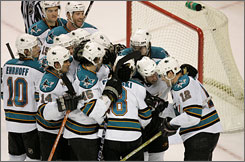 The Sharks, shown celebrating their game-winning goal against Ottawa in overtime on March 5, are on a club-record nine-game winning streak and hope to close out the regular season ahead of Anaheim and Dallas for a division title.